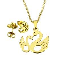 Set ketting & oorbellen edelstaal - zwaan / goud