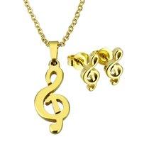Set ketting & oorbellen edelstaal - G-sleutel muziek / goud