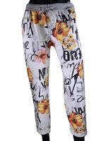 Dames comfy broek met bloemenprint - oranje / wit